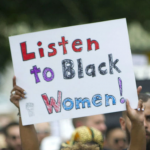 "Sign saying ""Listen to Black Women!"""